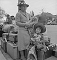 Hayward, California. These people of Japanese ancestry are awaiting the special bus which will take . . . - NARA - 537522.jpg