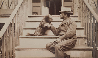 Henry Adams - Henry Adams seated with dog on steps of piazza, c. 1883