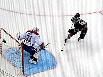 Carey Price - Price holds off a shoot out attempt against Jeff Skinner of the Carolina Hurricanes.