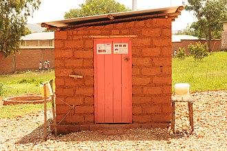 Improved sanitation - Improved sanitation example: pit latrine with a slab covering the drop hole and handwashing station in Burundi