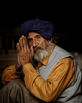 A farmer with folded hands at the 2020-21 Indian Farmers' Protest