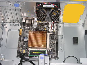 Mini-ITX - Mini-ITX 2.0 SoC mainboard with ATX12V connector installed in a Micro-ATX computer case.
