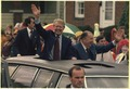 Jimmy Carter and Senator Jennings Randolph wave during a motorcade in Elkins, WV. - NARA - 181780.tif