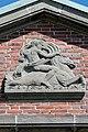 Johanneum (Hamburg-Winterhude).Bauschmuck.Weinberger.Giebel Nordflügel.Triton auf Wellenpferd.21907.ajb.jpg