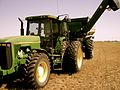 John Deere 8100 with grain cart.jpg