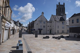 Kilwinning Abbey - Kilwinning's Main Street on a Sunday, shortly before a papingo shoot to be held at the Abbey tower to the right of the view.