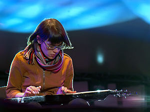 Kaki King - King, playing a lap steel guitar in the Adelaide International Guitar Festival