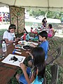 "Kids and adults painted with their hands in ""Art with your hands"".(Refuge Week Activity 2012) (8213579375).jpg"