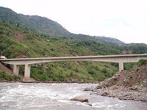 Kohala Bridge - View of Pakistani controlled Kashmir from the river bank.