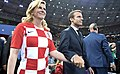 Kolinda Grabar-Kitarović and Emmanuel Macron prepare to award the first and second places in the final of the 2018 Russian Football Cup.jpg