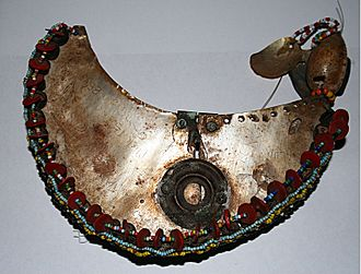 Gift economy - A Kula necklace, with its distinctive red shell-disc beads, from the Trobriand Islands.