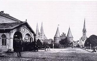 Lübeck Hauptbahnhof - Train leaving the old Hauptbahnhof, about 1865.