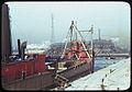 Lake freighter along dock at 92nd St. bridge near mouth of Calumet river. So. Chgo..jpg