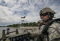 Loading slings in the eye of a helo-storm 150731-A-TI382-1048.jpg