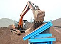 Loading the feed hopper with iron ore for washing (6325632314).jpg