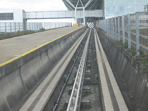 Third rail - London Stansted Airport people mover with central rail power feed