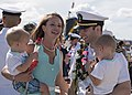 Lt. William Spears is greeted by his wife and childen following the completion of a six-month deployment to the Western Pacific Ocean (31064706481).jpg