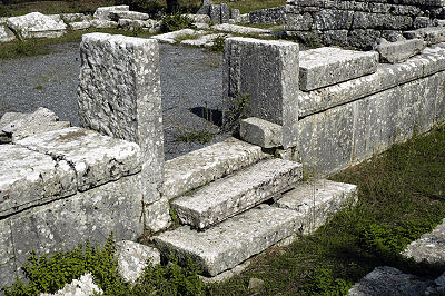 On either side of a doorway, the wall of the Temple of Despoina at Lycosura has a course of orthostates with string courses above them