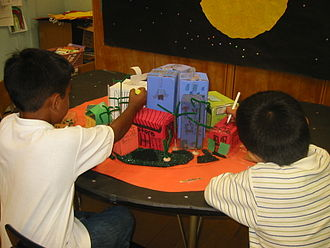 Magnet school - These 2nd graders from Buchanan Math Science Magnet School in Los Angeles, work on an art project. After studying the physical environment of the planet Mars, they are now designing a suitable Martian community.