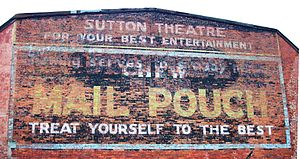 Mail Pouch Tobacco Barn - Originally, Bloch Brothers advertised on the walls of businesses, such as this theater in West Virginia