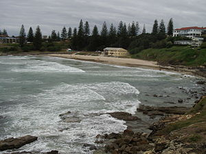 Yamba, New South Wales - A view of Main Beach, with the Yamba surf-lifesaving club in the centre and Pacific Hotel in the upper-right.