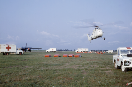 A makeshift airport in Calabar, Nigeria, where relief efforts to aid famine victims were deployed by helicopter teams Makeshift airport in Calabar, Nigeria, probably 1968.png
