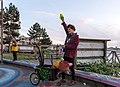 Man using a soap bubble machine on Spyglass Dock during golden hour (DSCF7448).jpg