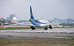 Mandarin Airlines Embraer ERJ 190 B-16825 Stand by at Taipei Songshan Airport Runway 20150101.jpg