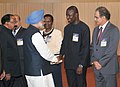 Manmohan Singh meeting the foreign delegates, at the inauguration of the 11th International Oil & Gas Conference and Exhibition – PETROTECH-2014, in Noida.jpg