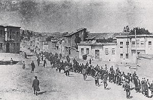 Armenian Genocide - Armenian civilians, escorted by Ottoman soldiers, marched through Harput (Kharpert) to a prison in nearby Mezireh (present-day Elâzığ), April 1915.