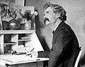 Mark Twain pondering at desk - part.jpg