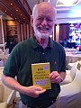 Marshall Goldsmith with a copy of 100 Things Successful People Do.jpg