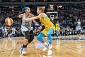 Maya Moore (23) handles the ball as she's guarded by Allie Quigley (14).jpg