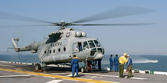 Mexican Naval Aviation - A Mi-8 helicopter of the Mexican Naval Air Force stands by for passengers on the flight deck aboard the amphibious assault ship USS Bataan, off the coast of Mississippi in 2005