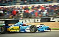 Michael Schumacher - Benetton B195 accelerates out of Copse at the 1995 Britsh GP, Silverstone (49717075567).jpg