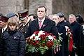 Ministru prezidents Valdis Dombrovskis piedalās svinīgajā vainagu nolikšanas ceremonijā Rīgas Brāļu kapos (8174998850).jpg