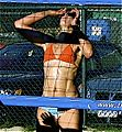 Muscular woman playing volleyball.jpg