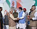 Narendra Modi being welcomed by the Governor of Punjab and Administrator of Chandigarh, Shri V.P. Singh Badnore and the Chief Minister of Punjab, Shri Parkash Singh Badal.jpg