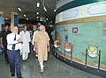 Narendra Modi going round the exhibition at the 86th Foundation Day of ICAR and ICAR award presentation ceremony, in New Delhi. The Union Minister for Agriculture, Shri Radha Mohan Singh.jpg
