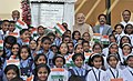 Narendra Modi with the children at the inauguration of the new CBSE building, at Vidya Pratisthan Campus, in Baramati, Maharashtra. The Governor of Maharashtra, Shri C. Vidyasagar Rao and other dignitaries are also seen.jpg
