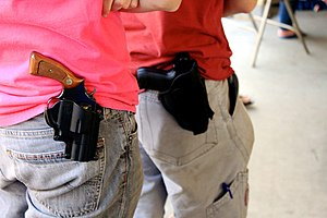 Open carry in the United States - Two New Hampshire residents openly carrying holstered pistols.