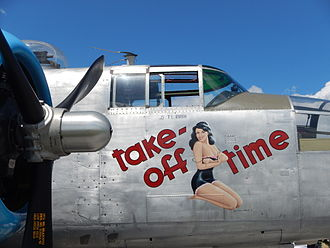 Pin-up model - Pin-up girl nose art on the restored World War II B-25J aircraft Take-off Time
