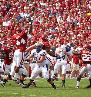 2009 Tulsa Golden Hurricane football team - Quarterback G.J. Kinne in a game against the Oklahoma Sooners.