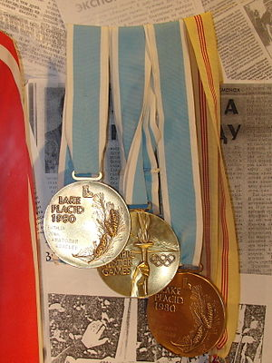 1980 Winter Olympics - Two gold and bronze Olympic medals from XIII Olympic Winter Games, designed by Gladys Gunzer