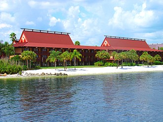 Disney's Polynesian Village Resort - Longhouses, such as the Tahiti Longhouse viewed here from the Seven Seas Lagoon, house all of the resort's rooms.