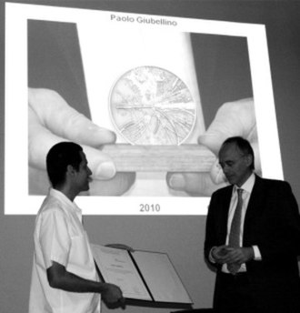 Paolo Giubellino - Paolo Giubellino is awarded the Medal of the Division of Particle and Fields by the Mexican Physical Society