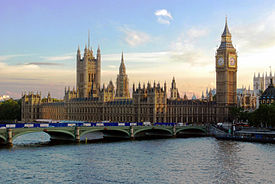 The Palace of Westminster with Elizabeth Tower and Westminster Bridge viewed from across the River Thames