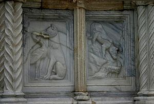 Aesop's Fables - A detail of the 13th-century Fontana Maggiore in Perugia with the fables of The Wolf and the Crane and The Wolf and the Lamb