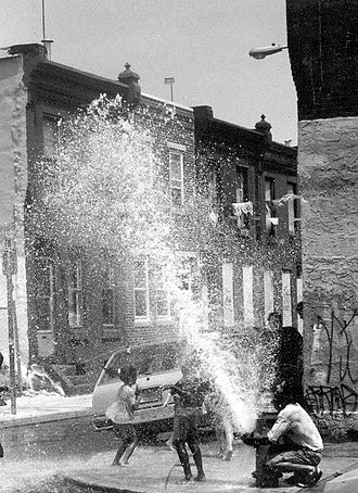 Fire hydrant - Children playing in the spray of a fire hydrant in Philadelphia, Pennsylvania.