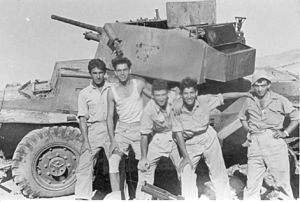 Operation Danny - Palmach (Yiftach brigade) soldiers with a (just destroyed by a PIAT) captured Jordanian army armored car, Operation Dani, al-Burj, 15 July 1948